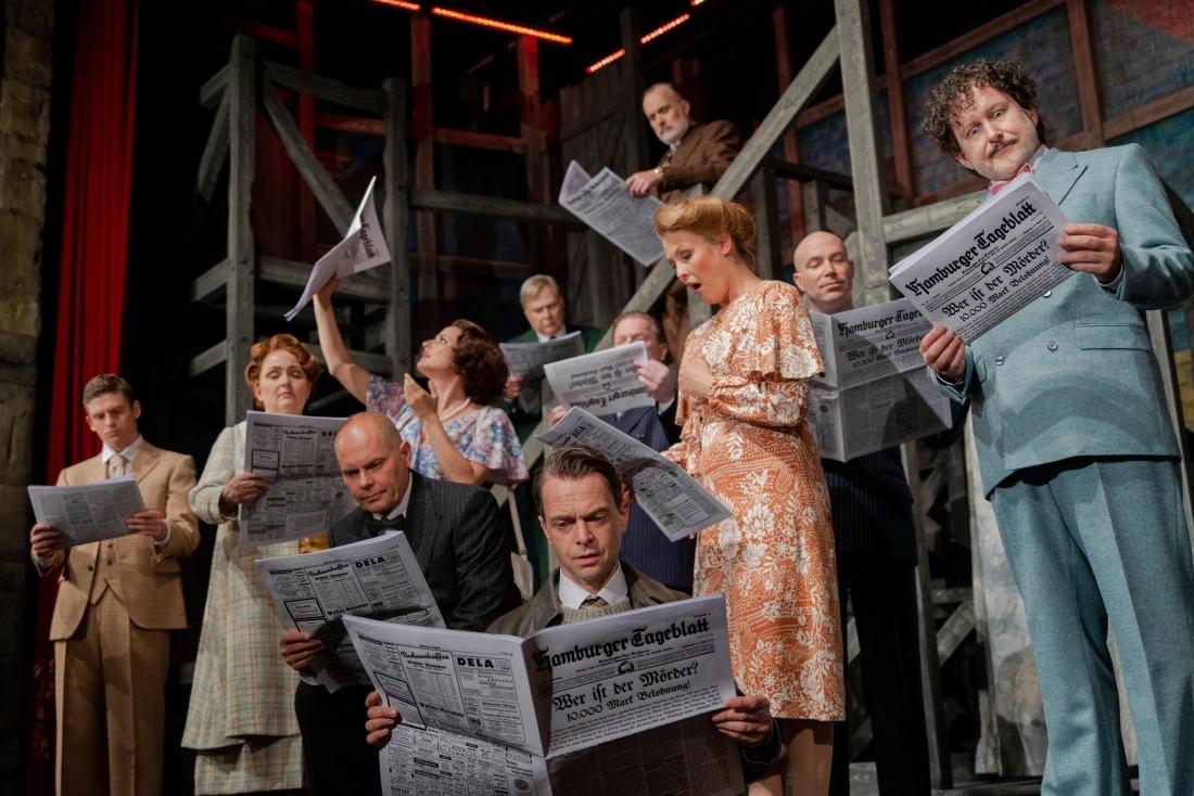 Klassiker: Menschen mit einer Zeitung