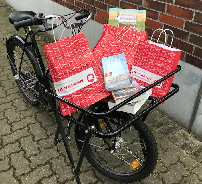 Heymann: Lastenfahrrad mit Büchern